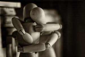 Wooden figures hugging
